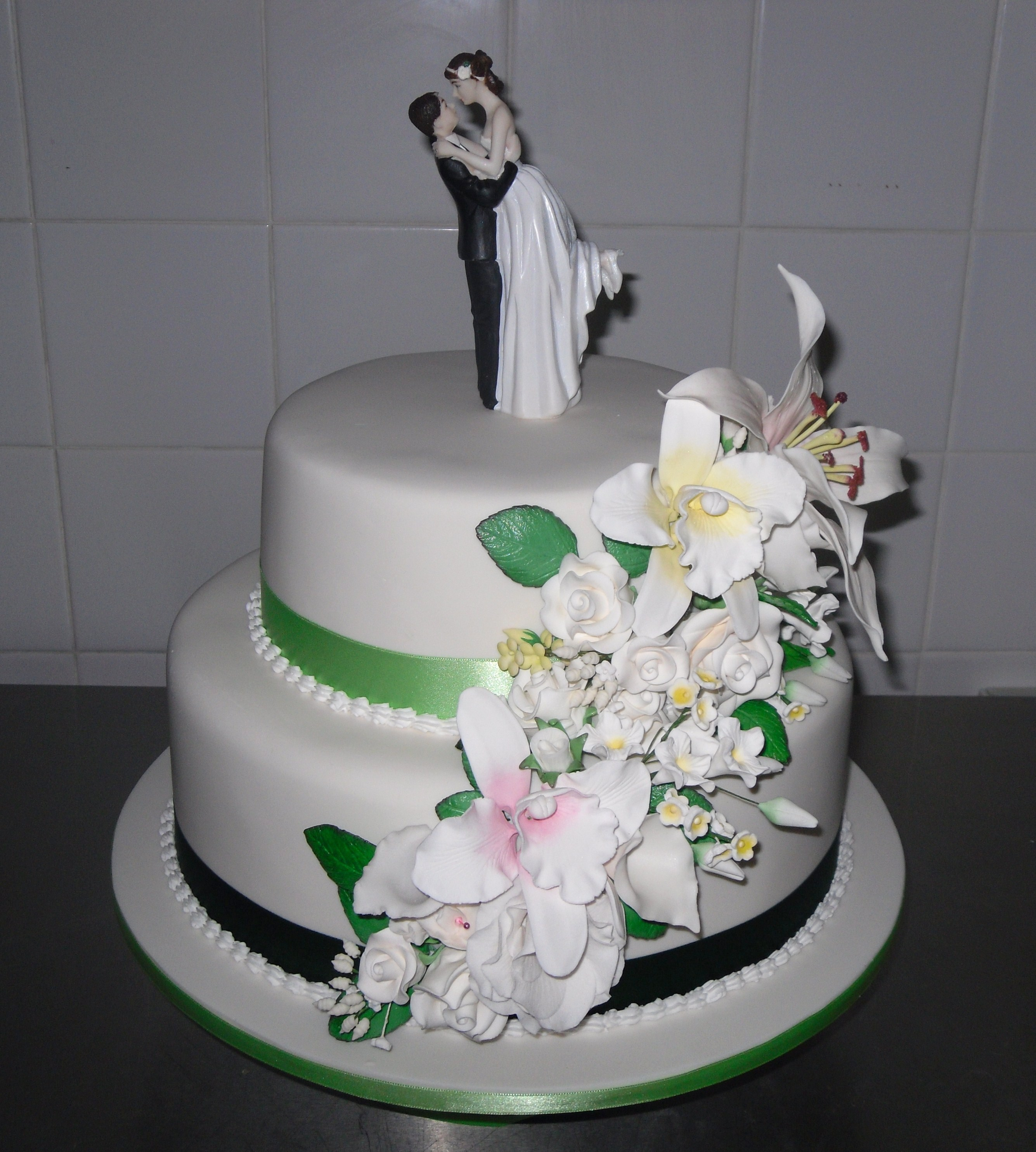 2 tier wedding cake with assorted flowers Annette s